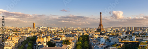 Fotobehang Eiffeltoren Panoramic summer view of Paris rooftops at sunset with the Eiffel Tower. 16th Arrondissement, Paris, France