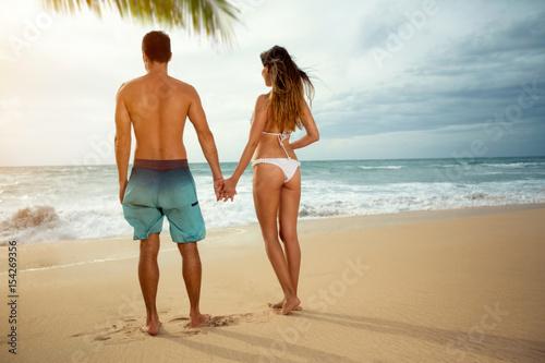 Romantic couple on sunset beach