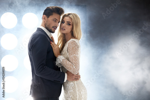 Fotobehang Konrad B. Elegant, attractive couple in the night club