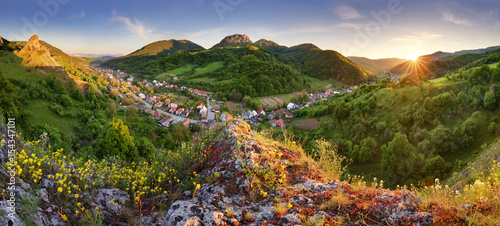 Poster Heuvel Beautiful landscape of valley in Slovakia mountains, small houses in village, rural scene, majestic picturesque view at sunset panorama
