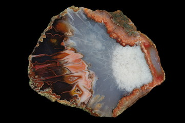 A cross section of the agate stone. Built with many pseudomorphs. Multicolored silica bands colored with metal oxides are visible. Origin: Asni, Atlas Mountains, Morocco.