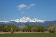 Snow capped Longs Peak and Mt Meeker on a spring or summer day