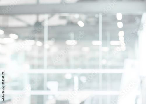 Abstract blur modern business office white and gray bokeh lights background with motion blur for your design