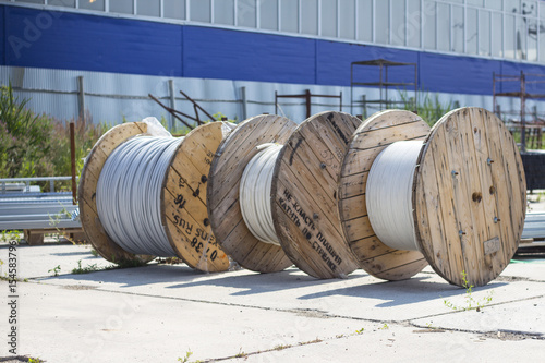 Wooden cable drums in range Poster