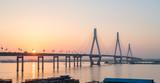 dongting lake bridge with setting sun