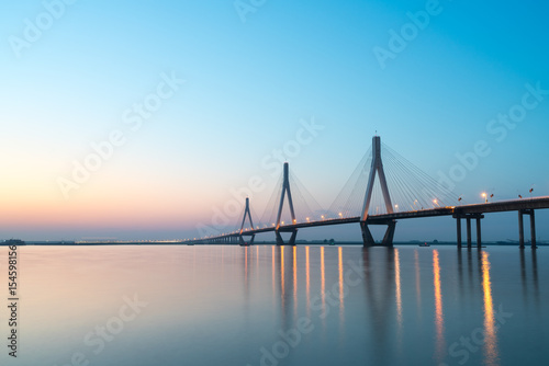 Poster dongting lake bridge in sunset