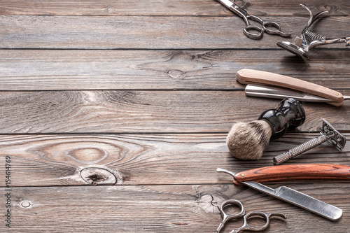Vintage barber shop tools on wooden background Poster