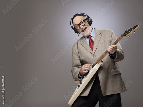 Senior man playing electric guitar Poster