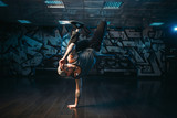 Breakdance performer posing in dance studio - 154634519