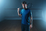 Fototapety Squash player with racket, indoor training court