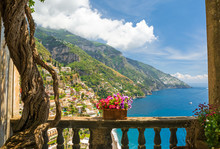 """Постер, картина, фотообои """"beautiful view of the town of Positano from antique terrace with flowers"""""""