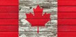 Canadian flag on a weathered rustic wood background