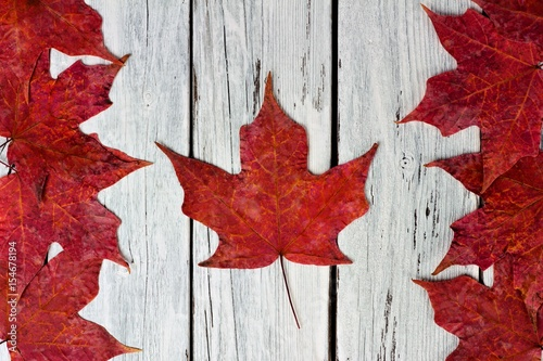 Aluminium Canada Canadian flag made of red maple leaves over a weathered white wood background