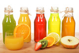 Colorful fruit juices in glass bottles for a healthy breakfast
