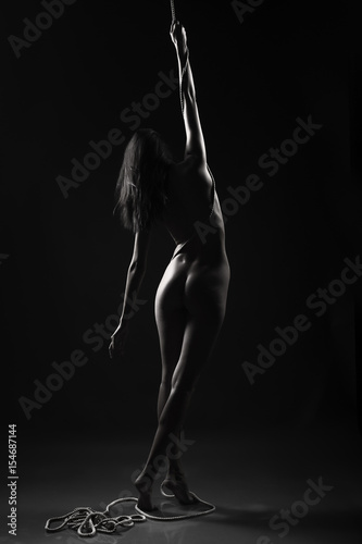 silhouette of the naked girl with the rope