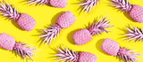 Fototapety Pink painted pineapples on a vivid yellow background