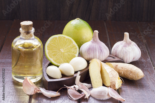 Garlic with lemon on wood Poster