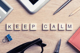 Keep calm concept collected of wooden elements with the letters - 154726968