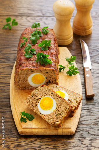 Baked meat loaf with eggs for Easter holiday. - 154727342