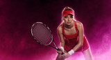Female tennis player in action on black background with pink steam
