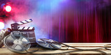 Film movie Background - Clapperboard And Film Reels In Theater - 154760711