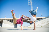 Breakdancers performing tricks