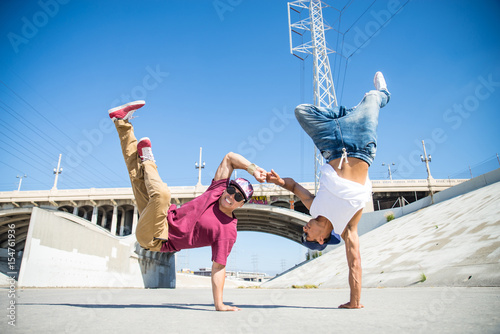 Breakdancers performing tricks Poster