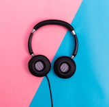 Headphones on a bright split background