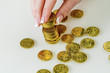save woman with stack of coins in the money - 154911754