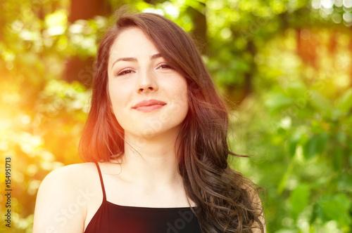 Summer portrait of a happy girl full of sunshine