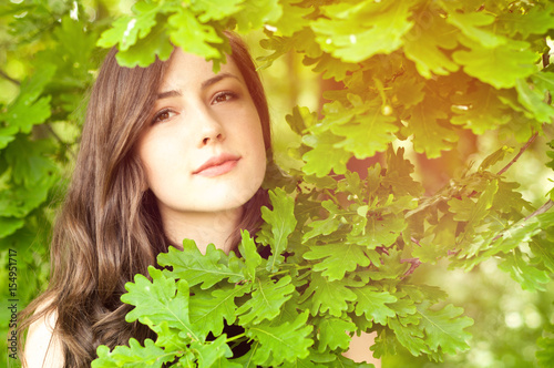 Romantic portrait of young female in the park