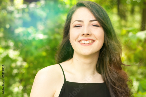 Closeup portrait with flares of cheerful lady