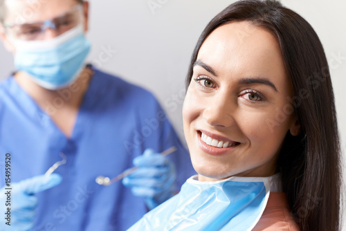 Young Woman Having Check Up And Dental Exam At Dentist - 154959520