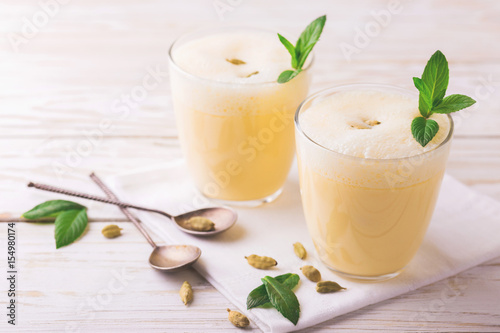 Foto op Aluminium Milkshake Traditional Indian mango lassi with cardamon, mint, vanilla and saffron