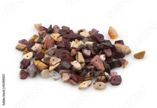 Natural stones crumb for ornaments on a white background Poster