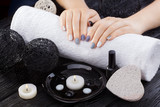 beautiful gray manicure with towel on the white wooden table. spa