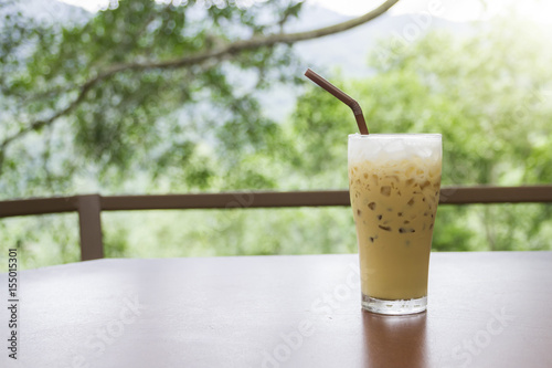 Fotobehang Thee Iced coffee on wooden table