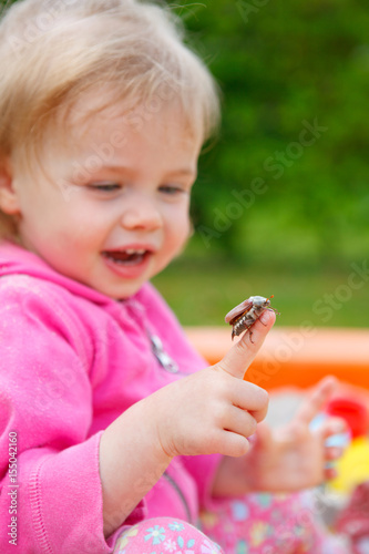 little girl with a cockchafer Poster