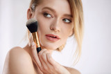 Beauty Makeup. Beautiful Young Female Model With Cosmetic Brush