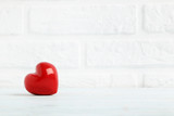 Red heart on a brick wall background