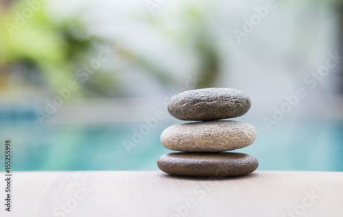 Foto op Canvas Zen Beautiful natural zen stone over blurred nature background, selective focus on stone