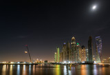 Dubai Marina waterfront in moonlight. May 2017