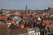 Panoramic aerial view on colorful red roofs of Ghent historic city center,  Belgium