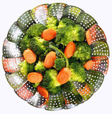 Broccoli and sliced carrots on stainless steel steamer. Steamed vegetables. - 155401374