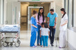Asian Indian Family, Doctor and Nurse in Hospital Corridor