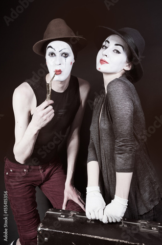 mimes woman and man with suitcase Poster