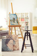 Chair, paintings and a canvas - 155418531