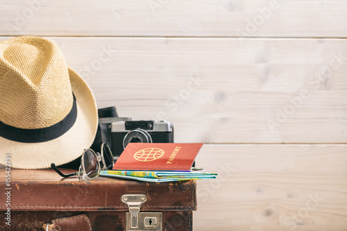 Travel concept on wooden background - copy space