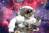 Astronaut in outer space. Elements of this image furnished by NASA. - 155424790