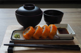 California maki roll in square plate Japanese style served with shoyu sauce and wasabi on table wood